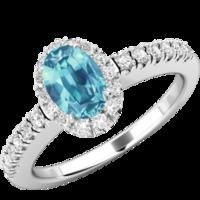 A beautiful Aquamarine and diamond cluster with shoulder stones in 18ct white gold